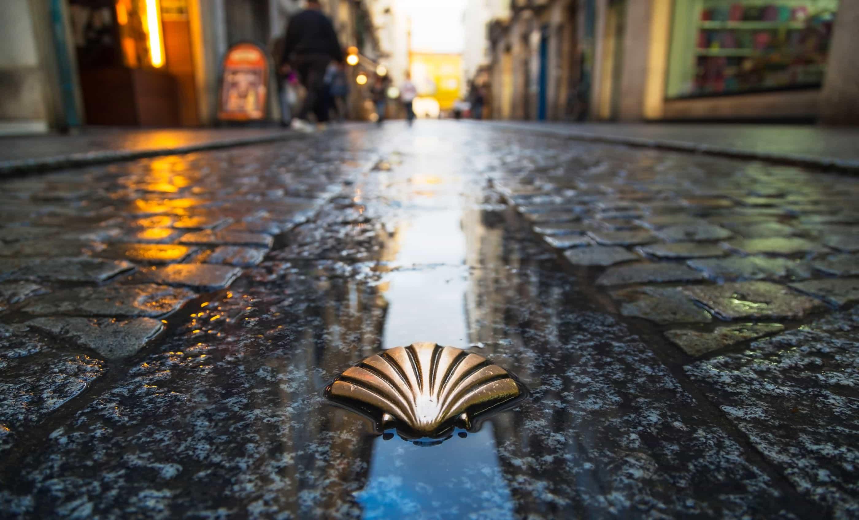 Camino de Santiago Shell on a cobble stone street
