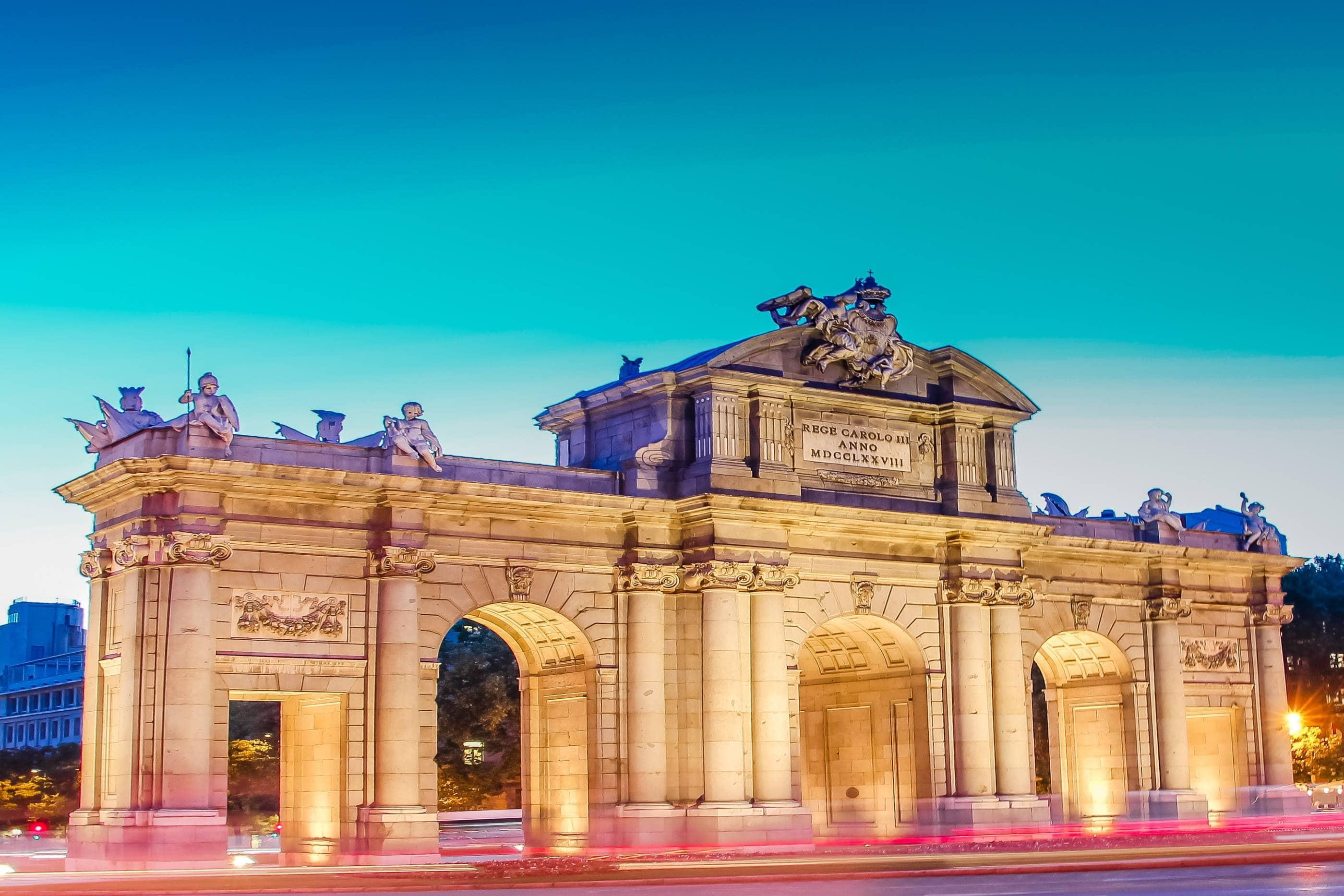 Madrid with Puerta de Alcalá by night - Photo by Tania Fernandez on Unsplash