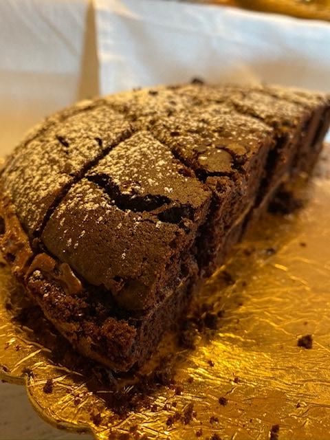Chocolate cake dessert on gold platter at Hotel Mirasole, Gaeta