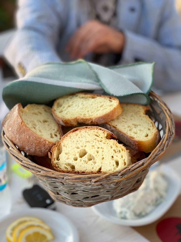 Fresh bread in Santorini with a hint of yellow from corn in a basket